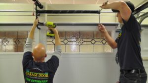 Why should heir a professional garage door repairs